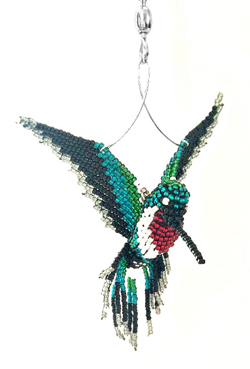 ruby hummingbird suncatcher closeup