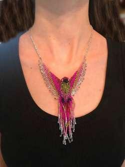Phoenix Beaded Hummingbird Necklace Pink and Light Green model