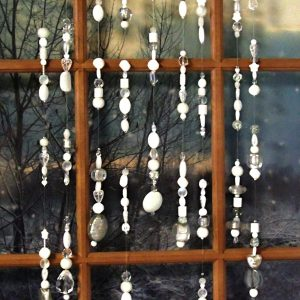 white beaded window curtains